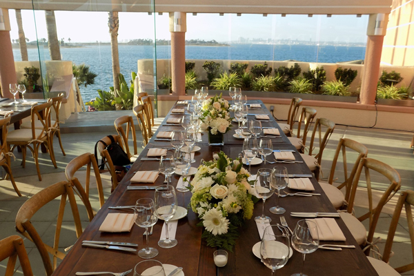 Professionally set table overlooking ocean
